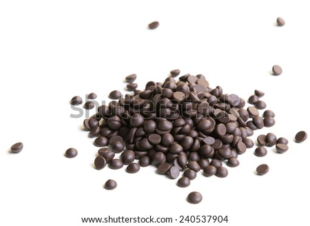 Chocolate morsels pile on white background - stock photo