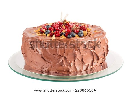 Chocolate mousse cake with berries isolated on white - stock photo