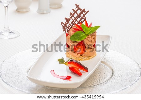 chocolate mousse desert with strawberry, on a classy restaurant table