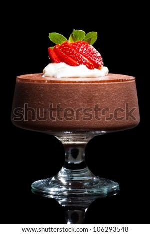 Chocolate mousse dessert with strawberries and cream. Isolated on black. - stock photo