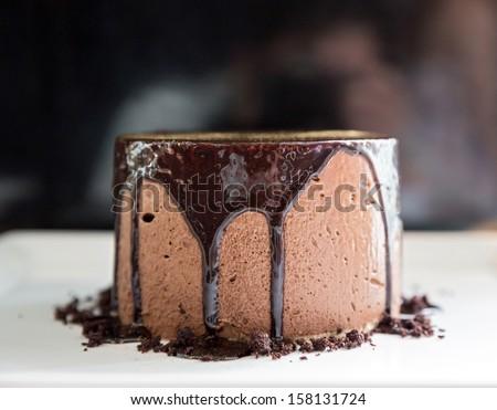 Chocolate mousse Lava Cake on white dish - stock photo