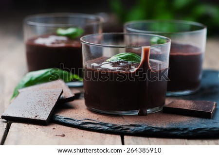 Chocolate mousse with basil, selective focus - stock photo