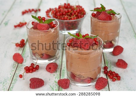 Chocolate mousse with raspberries on a white background - stock photo
