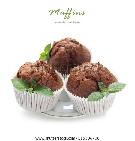 Chocolate muffin with fresh mint on the white background - stock photo