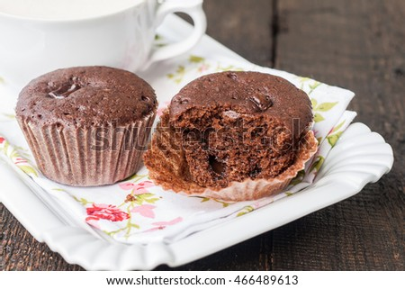 chocolate muffins, cakes and cup of coffee.
