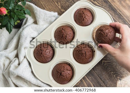 Chocolate muffins with crispy top (selective focus) - stock photo