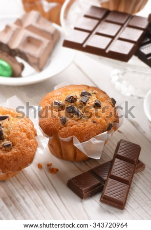 chocolate muffins with homemade ingredients around