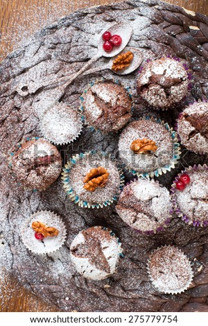 Chocolate muffins with powdered sugar