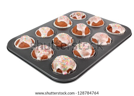 Chocolate Muffins with Sugar Icing. Isolated with clipping path. - stock photo