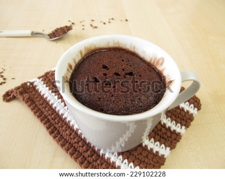 Chocolate mug cake in cup from microwave  - stock photo