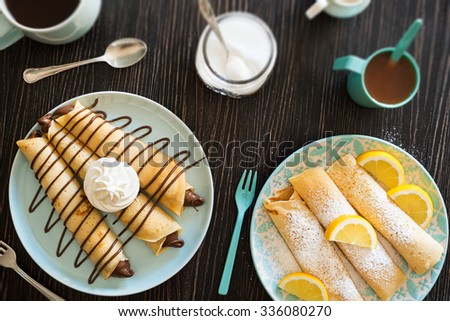 Chocolate Nutella Dessert Crepes and Lemon Powdered Sugar Crepes with Coffee