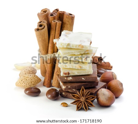 Chocolate, nuts, cinnamon and anise. Spices.  - stock photo