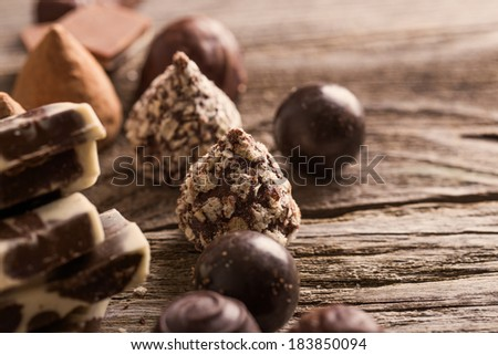 chocolate on old wooden table - stock photo