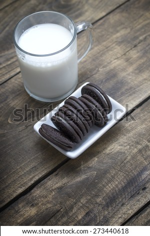 Chocolate oreo cookies and milk  on the table - stock photo