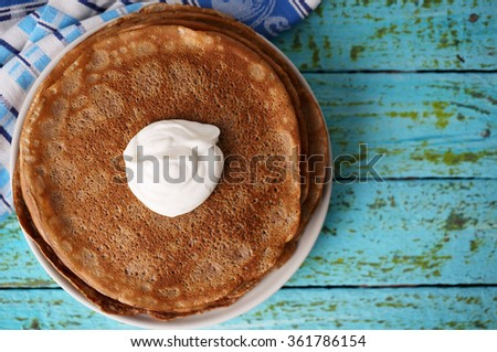 chocolate pancakes with sour cream for carnival - stock photo