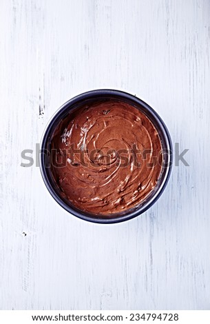 Chocolate pastry in a cake tin (seen from above) - stock photo