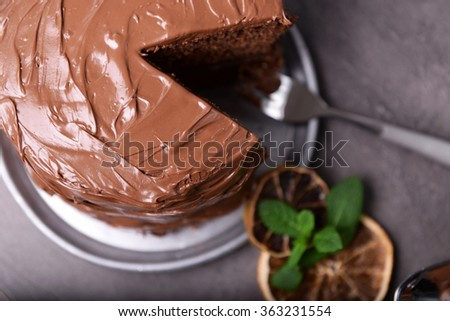 Chocolate pie with fork and ingredients on table - stock photo