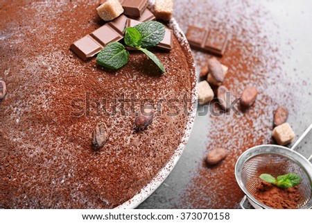Chocolate pie with ingredients and sieve, closeup - stock photo