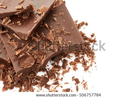 Chocolate pieces and chocolate shavings isolated on white background
