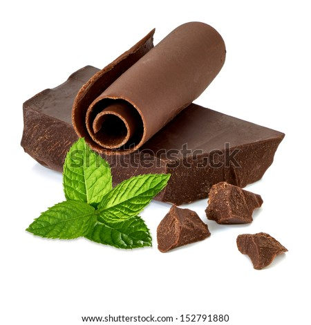 Chocolate pieces and curl with mint on white background - stock photo