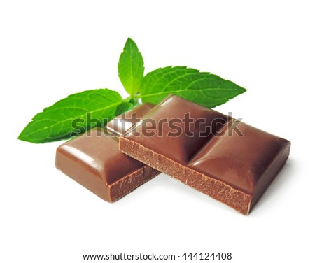 Chocolate pieces and mint leaves, isolated on white.