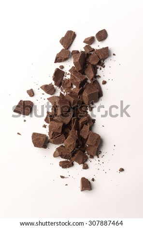 chocolate pieces on white background - stock photo