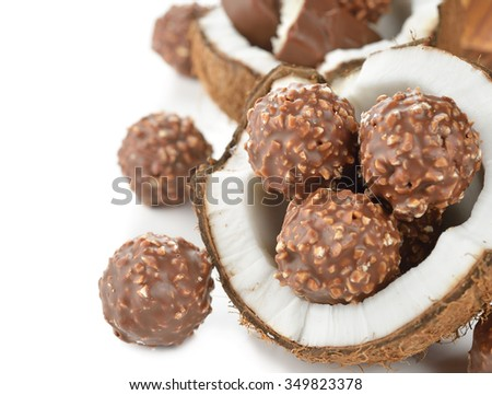 Chocolate praline and coconut on a white background - stock photo