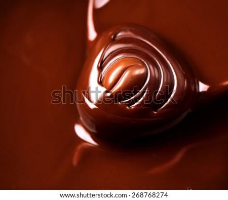 Chocolate praline. Chocolates background. Chocolate. Liquid chocolate. dark and milk chocolate. Sweets - stock photo