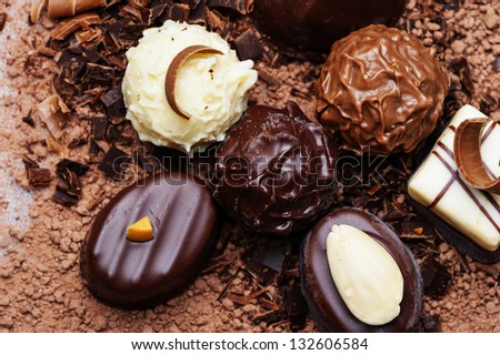 chocolate pralines on a chocolate background - stock photo