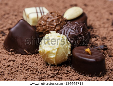 chocolate pralines on chocolate background - stock photo