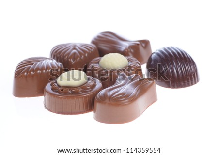 chocolate pralines on white background. Delicious dark and milk chocolate pralines.