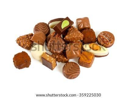 chocolate pralines over white - stock photo