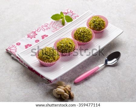 chocolate pralines with pistachio - stock photo