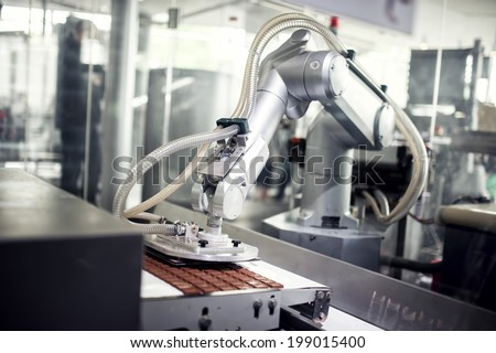 Chocolate production line in industrial factory. Automatic process in production line - stock photo