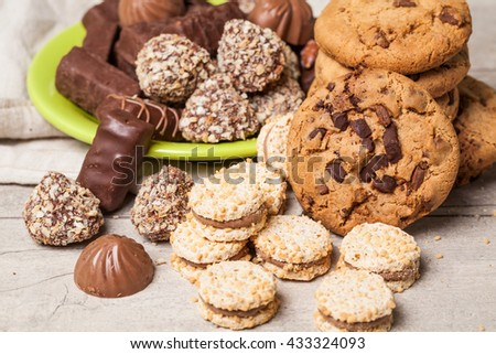 Chocolate products on wooden table. Cookie, candy.