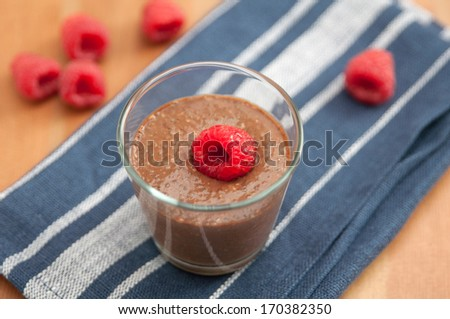 Chocolate Pudding with raspberries and chia seeds - stock photo