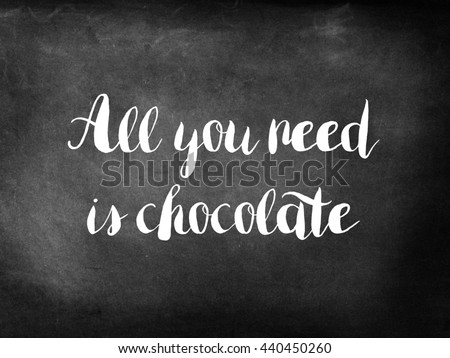 Chocolate quote on chalkboard - stock photo