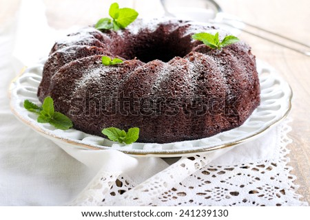 Chocolate ring cake with icing sugar - stock photo
