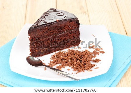 Chocolate sacher cake on wooden table - stock photo