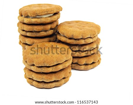 chocolate sandwich biscuits with cream filling on a white background