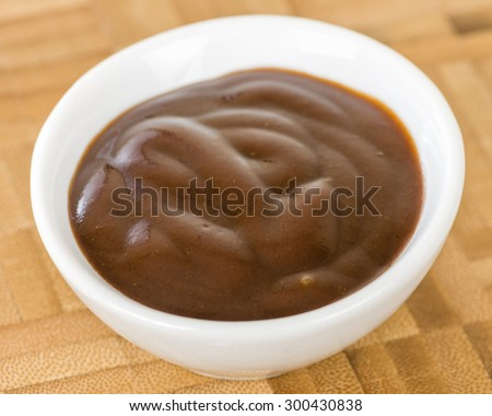 Chocolate Sauce - Bowl of chocolate dip on a wooden background