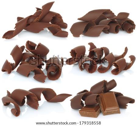 Chocolate shavings set on white background   - stock photo