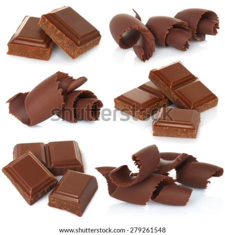 Chocolate shavings with blocks set on white background  - stock photo