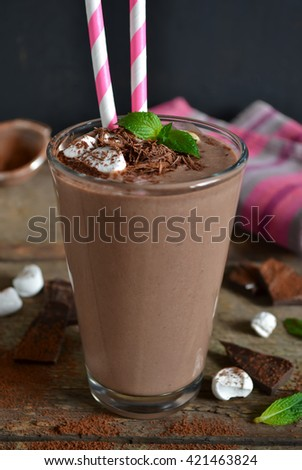 chocolate smoothie with oats and marshmallow on a wooden background - stock photo