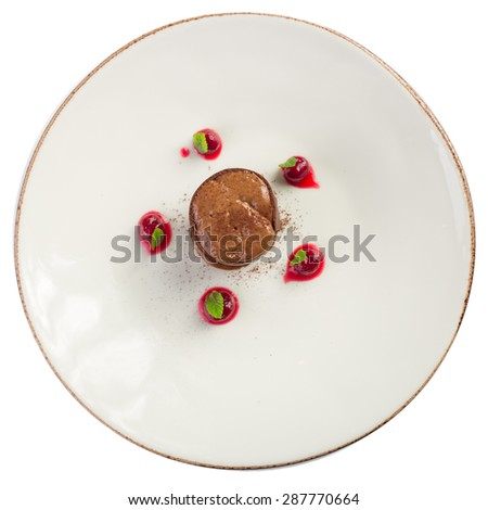 Chocolate souffle with cherries isolated on white background - stock photo