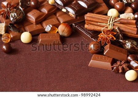 Chocolate, spices and nuts on a linen napkin.