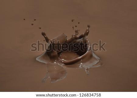 chocolate splash closeup - stock photo