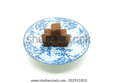 Chocolate stacking on dish - stock photo