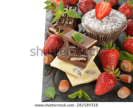 Chocolate, strawberries and mint on a white background - stock photo