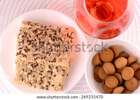chocolate sweet cake on white plate and red wine or juice - stock photo